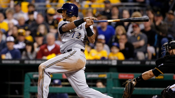 April 18, 2014: Milwaukee Brewers' Martin Maldonado drives in Scooter Gennett with a single off Pittsburgh Pirates starting pitcher Charlie Morton during the fourth inning of a baseball game in Pittsburgh.