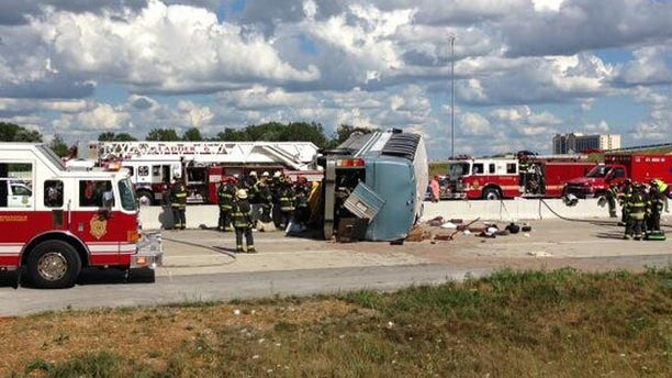 July 27, 2013: Authorities attend to an overturned bus that crashed on Interstate 465, killing three people.