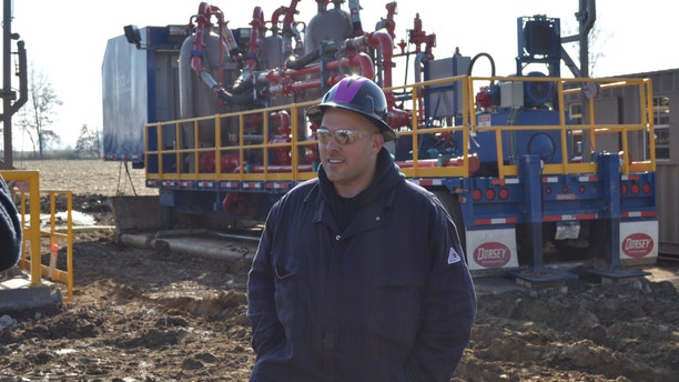 """CJ Cutter walks across the drill site, located in Kristin's backyard in West Salem, Ohio during """"Blood and Oil."""""""