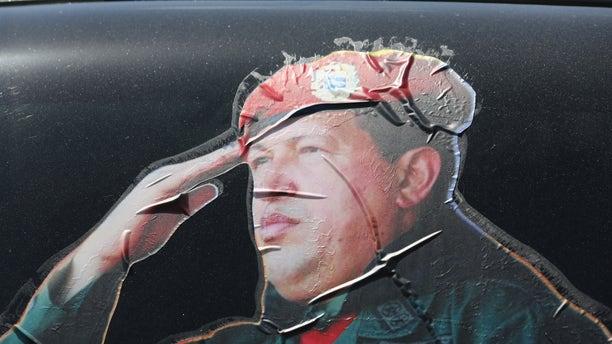 CARACAS, VENEZUELA - MARCH 04: A sticker on a car window honors former Venezuelan president Hugo Chavez near the military barracks where Chavez is entombed on March 4, 2014 in Caracas, Venezuela. (Photo by John Moore/Getty Images)