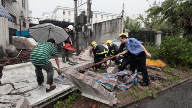 April 17: In this photo released by China's Xinhua News Agency, rescue team tries to save a resident trapped under a house which collapsed in a storm disaster in Foshan City, China's Guangdong Province.