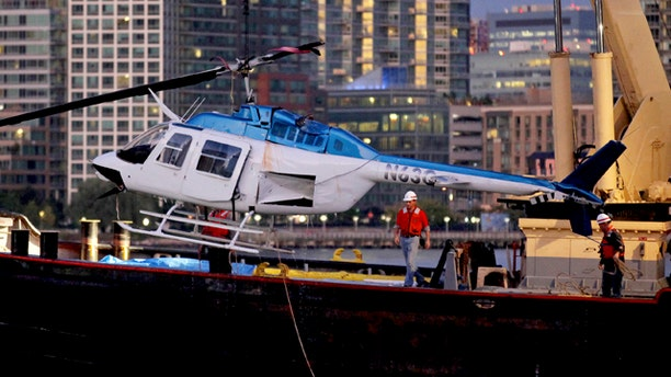 Oct. 4: A helicopter that crashed into the East River in New York is hoisted from the water.
