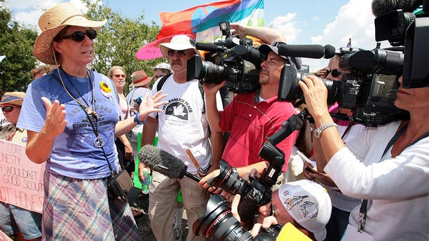 Anti-war activist Cindy Sheehan speaks to the press after being denied access to the ranch of U.S. President George W. Bush in Crawford, Texas, in 2006.