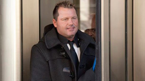 In this Feb. 2, 2011 file photo, former Major League Baseball pitcher Roger Clemens leaves federal court in Washington. Clemens says he's eager to defend himself in federal court this summer. The seven-time Cy Young winner says prosecutors have damaged the reputations of others as they've tried to prove that he lied to a congressional committee about alleged steroid use.