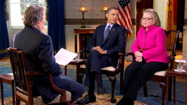 "In this Jan. 25, 2013 image taken from video and provided by CBS, President Barack Obama, center, and Secretary of State Hillary Rodham Clinton speak with ""60 Minutes"" correspondent Steve Kroft, left, in the Blue Room of the White House in Washington."