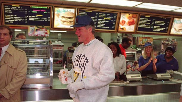 Then-President Clinton leaves an Arkansas McDonald's, sans Big Mac, in this 1993 AP File Photo