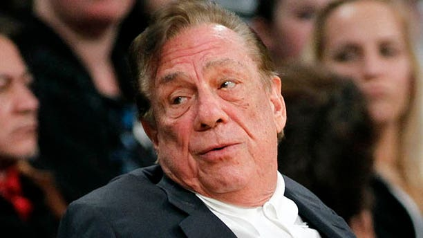 FILE - In this Dec. 19, 2011, file photo, Los Angeles Clippers owner Donald Sterling gestures while watching the Clippers play the Los Angeles Lakers during an NBA preseason basketball game in Los Angeles.  (AP Photo/Danny Moloshok, File)