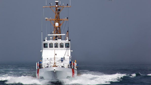 A smuggler's vessel rammed a small U.S. Coast Guard boat deployed by the cutter Halibut, off the Southern California coast early Sunday Dec. 2, 2012, killing one Coast Guard member and injuring another, authorities said. (AP Photo/U.S. Coast Guard/Steve Lee)