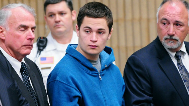 May 2: Christopher Plaskon, 16, second from right, stands with defense attorneys during his public court appearance in Milford, Conn.