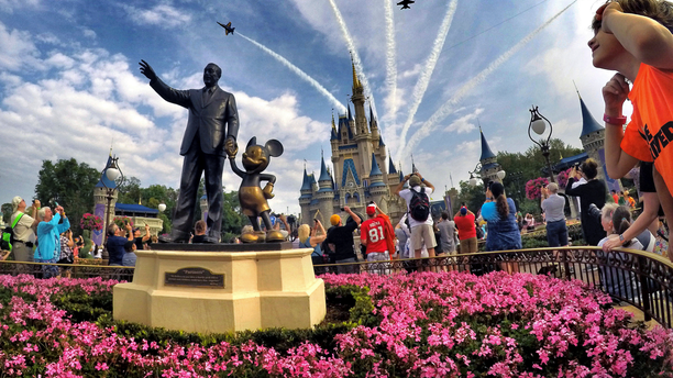 FILE- In this April 16, 2017 file photo, the Blue Angels, the U.S. Navy's legendary flight performance squadron, fly in formation over Cinderella Castle and the 'Partners' statue at the Magic Kingdom at Walt Disney World, in Bay Lake, Fla. Florida emergency officials said Thursday, Sept. 13, 2018, they had no way of tracking how many residents from the Carolinas had escaped to Florida this week. But some hotels were offering special discounts for evacuees and Florida ports were opening their terminals to cruise ships making unexpected ports of call.(Joe Burbank/Orlando Sentinel via AP, File)