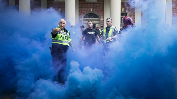 Police deploy smoke bombs into a crowd to disperse protesters after making arrests on the campus of the University of North Carolina campus in Chapel Hill, N.C., on Saturday, Sept. 8, 2018. Supporters and opponents of the Silent Sam statue faced off again late Saturday afternoon on the UNC campus, yelling at each other at the base where the Confederate monument was toppled last month. (Julia Wall/The News & Observer via AP)