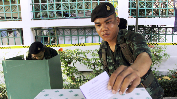 FILE - In this Feb. 2, 2014, file photo, a Thai soldier casts his vote during the general election at a polling station in Bangkok, Thailand. Thailand has taken another step toward holding elections next year in 2019 by easing some restrictions on political activities to allow parties to conduct basic functions, but they are still barred from campaigning. (AP Photo/Apichart Weerawong, File)