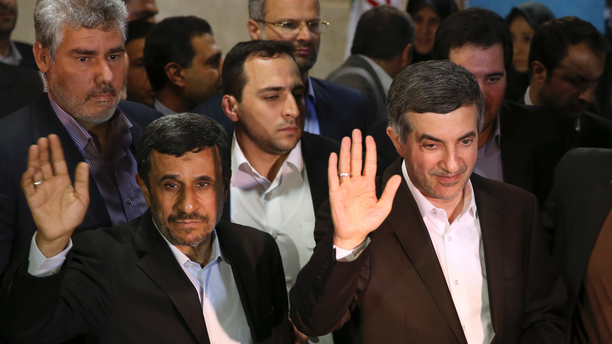 FILE - In this May 11, 2013 file photo, Iranian President Mahmoud Ahmadinejad, left, and his close ally Esfandiar Rahim Mashaei wave to journalists as they arrive at the election headquarters of the interior ministry in Tehran, Iran. The semi-official ISNA news agency reported Wednesday, Sept. 12, 2018, that a court has sentenced Mashaei to six-and-a-half years in prison. The report quotes Tehran Justice Department chief Gholamhossein Esmaili as saying Mashaei was sentenced to five years for plotting and conspiring to commit crimes against national security, one year for propaganda against the Islamic Republic system and six months for insulting officials. (AP Photo/Ebrahim Noroozi, File )