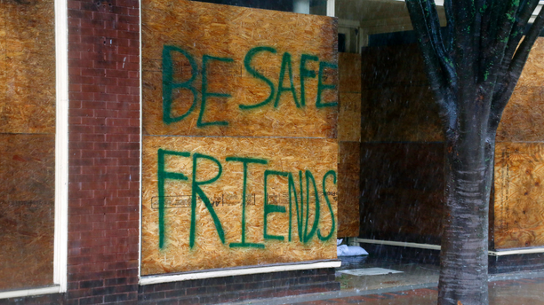 A message on a boarded-up business encourages people to be safe as Hurricane Florence hits downtown New Bern, N.C., on Friday, Sept. 14, 2018. (AP Photo/Chris Seward)