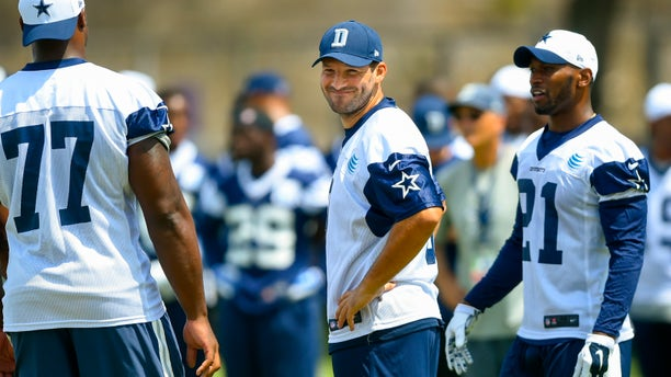 Dallas Cowboys quarterback Tony Romo (9) reacts after a botched play during the team's NFL football training camp, Thursday, July 30, 2015, in Oxnard, Calif. (AP Photo/Gus Ruelas)