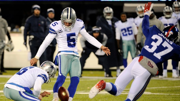 Dallas Cowboys kicker Dan Bailey (5), with Chris Jones holding, kicks a game-winning field goal against the New York Giants during the second half of an NFL football game, Sunday, Nov. 24, 2013, in East Rutherford, N.J.