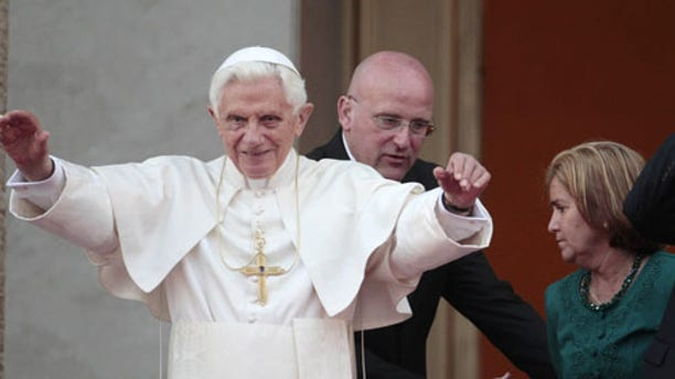 Pope Benedict XVI, left, and Cuba's President Raul Castro wave to journalists after a meeting in Havana, Tuesday, March 27, 2012. (AP Photo/Gregorio Borgia)