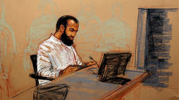 In this photo of a sketch by courtroom artist Janet Hamlin and reviewed by the Defense Department, accused 9-11 co-conspirator Ali Abd al-Aziz Ali, is shown at  his military hearing in Guantanamo Bay.