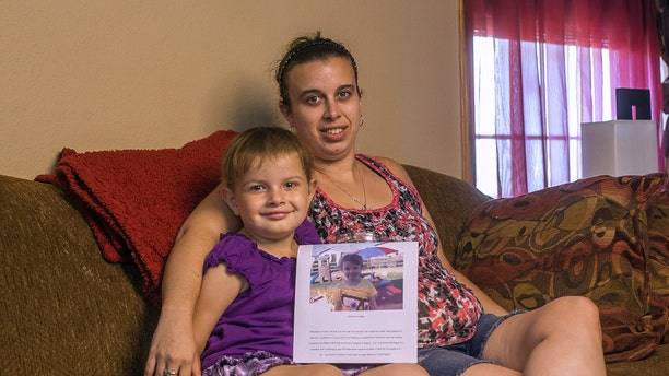 May 7, 2012:  In this file photo, Whitney Hughs and her daughter McKenna May are seen at their home in Haskins, Ohio.
