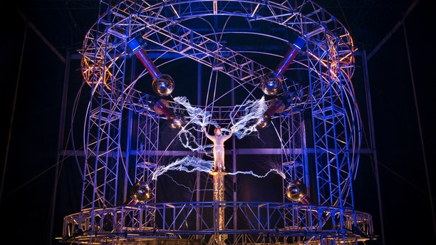 """Oct. 5, 2012: Magician David Blaine stands inside an apparatus surrounded by a million volts of electric currents streamed by tesla coils during his 72-hour """"Electrified: 1 Million Volts Always On"""" stunt on Pier 54"""