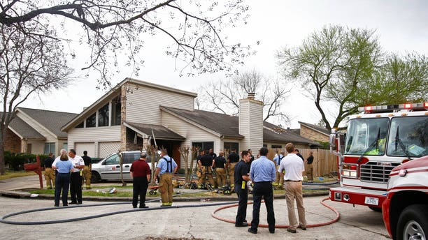Emergency Personnel respond to the location where a fire broke out at a day care operated by Jessica Tata, 22, lkilling three children and injuring four others Thursday, Feb. 24, 2011, in Houston.