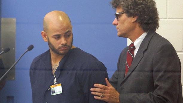 Robert Corchado and his attorney Daniel Tumarkin Monday, April 14, 2014.