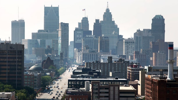 DETROIT, MI - JULY 19: A view of Downtown Detroit looking south on Woodward Avenue is shown July 19, 2013 in Detroit, Michigan. Detroit's emergency manager Kevin Orr filed for Chapter 9 bankruptcy July 18, 2013 making Detroit the largest city to file for bankruptcy in U.S. history. (Photo by Bill Pugliano/Getty Images)