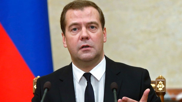 Aug. 7, 2014: Russian Premier Dmitry Medvedev announces sanctions at the Cabinet meeting in Moscow.