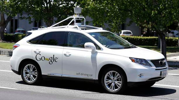 FILE - In this May 13 2014, file photo, a Google self-driving car goes on a test drive near the Computer History Museum in Mountain View, Calif. (AP)