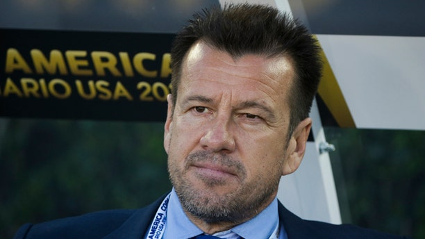 Brazil head coach Dunga sits on the bench before the team's Copa America Centenario Group B soccer match against Ecuador at the Rose Bowl, Saturday, June 4, 2016, in Pasadena , Calif. (AP Photo/Jae C. Hong)