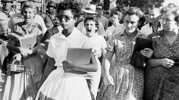 Elizabeth Eckford, one of the 'Little Rock Nine' is pursued by white students.