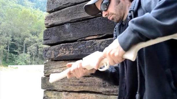 """A man who would identify himself only as """"Matthew"""" fires a homemade rifle he calls """"The Grizzly 2.0"""" in a YouTube video."""