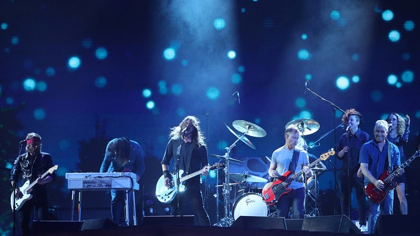 The Foo Fighters played a pickup soccer game with members of the University of Kentucky men's and women's soccer team.