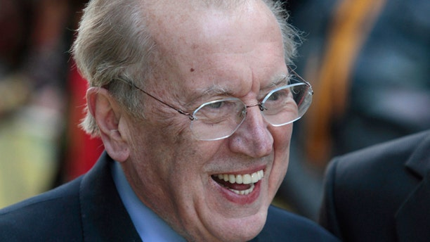 May 9, 2011: Broadcaster Sir David Frost poses for the photographers as he arrives for the European premiere of the 'Fire in Babylon' film at a central London cinema.