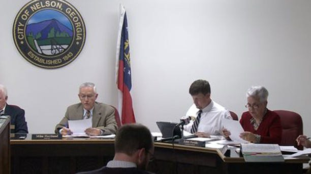 April 1, 2013: The Nelson, Ga. City Council meets to vote on a mandatory gun ownership ordinance for all heads-of-household.