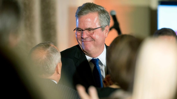 Dec. 2, 2014: Former Florida Gov. Jeb Bush talks to supporters after speaking at the U.S. Cuba Democracy PAC's 11th Annual Luncheon in Coral Gables, Fla. (AP Photo/J Pat Carter)