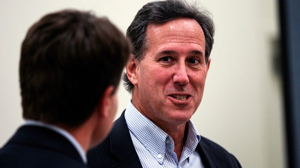 Oct. 3, 2015: Republican presidential candidate former Sen. Rick Santorum, R-Pa., prepares to speak during the Practical Federalism Forum hosted by American Principles Project held at Southern New Hampshire University in Hooksett, N.H. (AP Photo/Cheryl Senter)