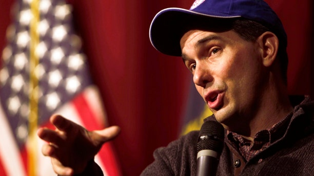 March 14, 2015: Wisconsin Gov. Scott Walker answers questions at a training workshop for the state Republican Party in the auditorium at Concord High School in Concord, N.H. (AP Photo/Jim Cole)