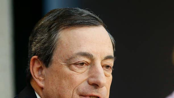 President of the European Central Bank, ECB, Mario Draghi speaks during a news conference in Frankfurt, Germany, Thursday,  April 3, 2014, following a meeting of the ECB governing council. The ECB decided to leave its main interest rate unchanged. (AP Photo/Michael Probst)
