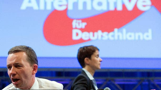 In this July 4, 2015 picture Alternative fuer Deutschland party co-chairs Bernd Lucke , left, and Frauke Petry  attend  the party conference in Essen, Germany.  The upstart Alternative for Germany party has replaced its euroskeptic leader with a conservative from the east who wants to place greater emphasis on immigration. A majority of AfD members backed Frauke Petry in the leadership vote Saturday against Bernd Lucke, who led the party during its successful bids in the past two years to enter the European Parliament and five German state assemblies.(Frederico Gambarini/dpa via AP))