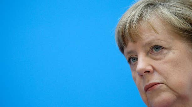 German Chancellor Angela Merkel attends a press conference in Berlin, Germany, Monday, May 11, 2015, the day after the state election in the German state of Bremen. Germany's main center-left party won the election in the country's smallest state, Bremen, and is expected to prolong its decades-long dominance there despite losing significant support. (AP Photo/Michael Sohn)