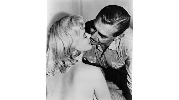 """Marilyn Monroe filming """"The Misfits"""" opposite Clark Gable."""
