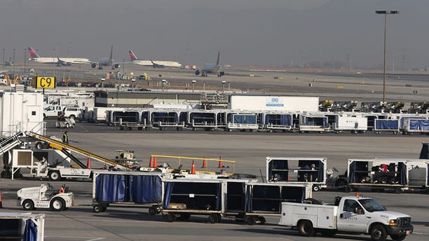 SALT LAKE CITY, UT - NOVEMBER 27: Delta planes stack up for take-off and are proceed through the Salt Lake City international Airport on November 27, 2013 in Salt Lake City, Utah.  A wintry storm system that is covering much of the nation is threatening to wreak havoc on holiday travel . (Photo by George Frey/Getty Images)