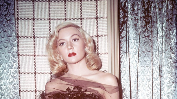 Gloria Grahame (1923-1981), US actress, poses wearing a chiffon bodice in a studio portrait, circa 1945. (Photo by Silver Screen Collection/Getty Images)