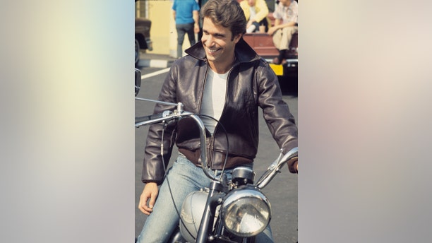"""""""Happy Days"""" star Fonzie (Henry Winkler) sits on his motorcycle."""