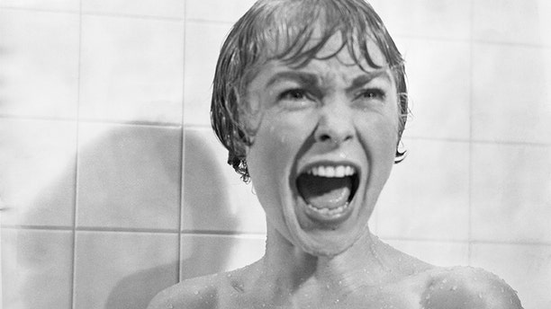 """In the shower scene from the film """"Psycho,"""" Marion Crane (played by Janet Leigh) screams in terror as Norman Bates tears open her shower curtain."""