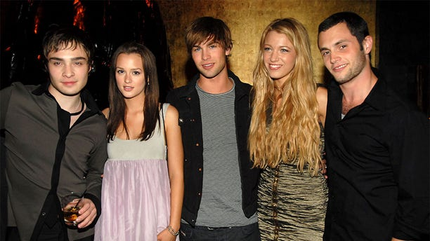 """Penn Badgley (right) with his former """"Gossip Girl"""" castmates."""