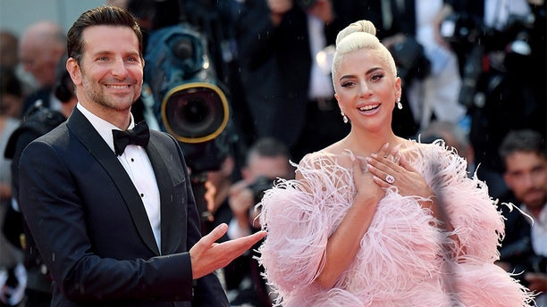 """Bradley Cooper and Lady Gaga take turns sharing the spotlight at the 'A Star Is Born""""' premiere during the Venice Film Festival."""
