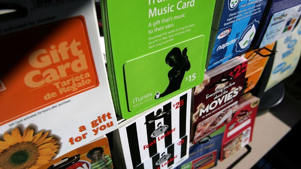 SAN FRANCISCO - DECEMBER 19:  Gift cards from various retailers are seen on display at a Chevron service station convenience store December 19, 2006 in San Francisco, California. According to the trade group National Retail Federation, holiday gift buyers will purchase an estimated $24.8 billion in gift cards, up 34 percent from last year.  (Photo by Justin Sullivan/Getty Images)
