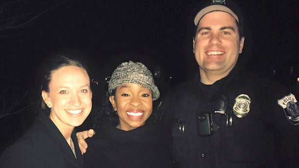 This photo provided by officer Paul Rogerson shows Rogerson, right, of the Pleasant Grove Police Department in Utah, singer Gladys Knight, center, and Rogerson's wife, left.  (Courtesy of Paul Rogerson via AP)